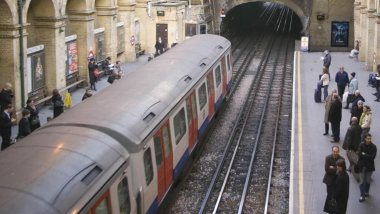 A tube train pulling into an underground station