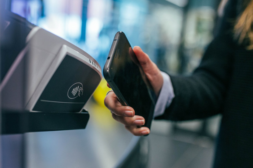 A contactless payment being made via smartphone
